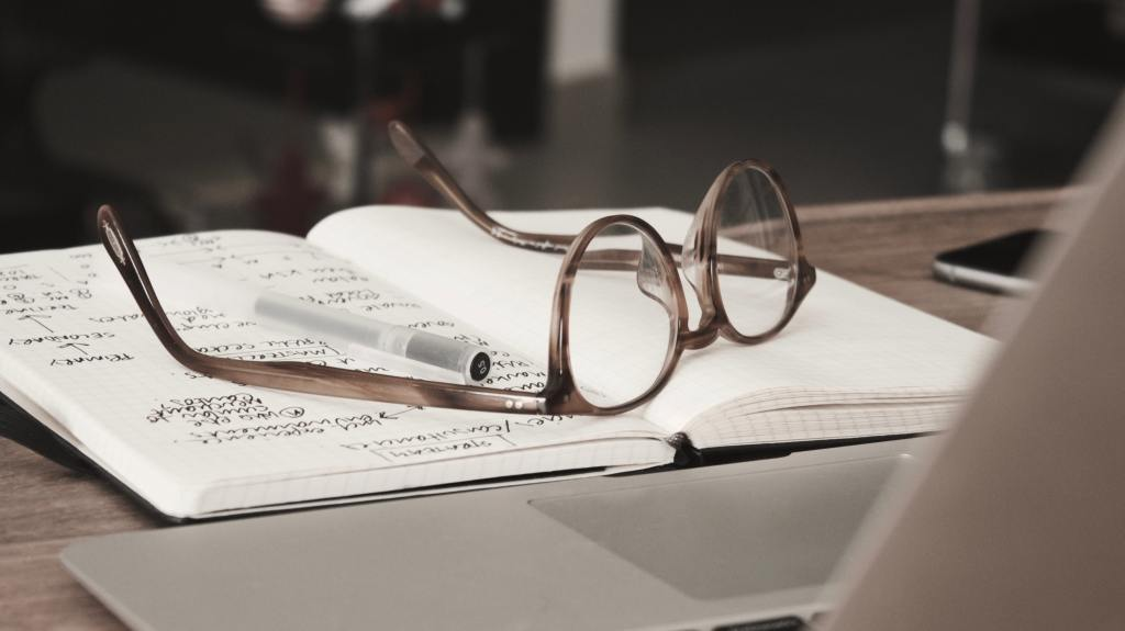 Glasses on a notebook.
