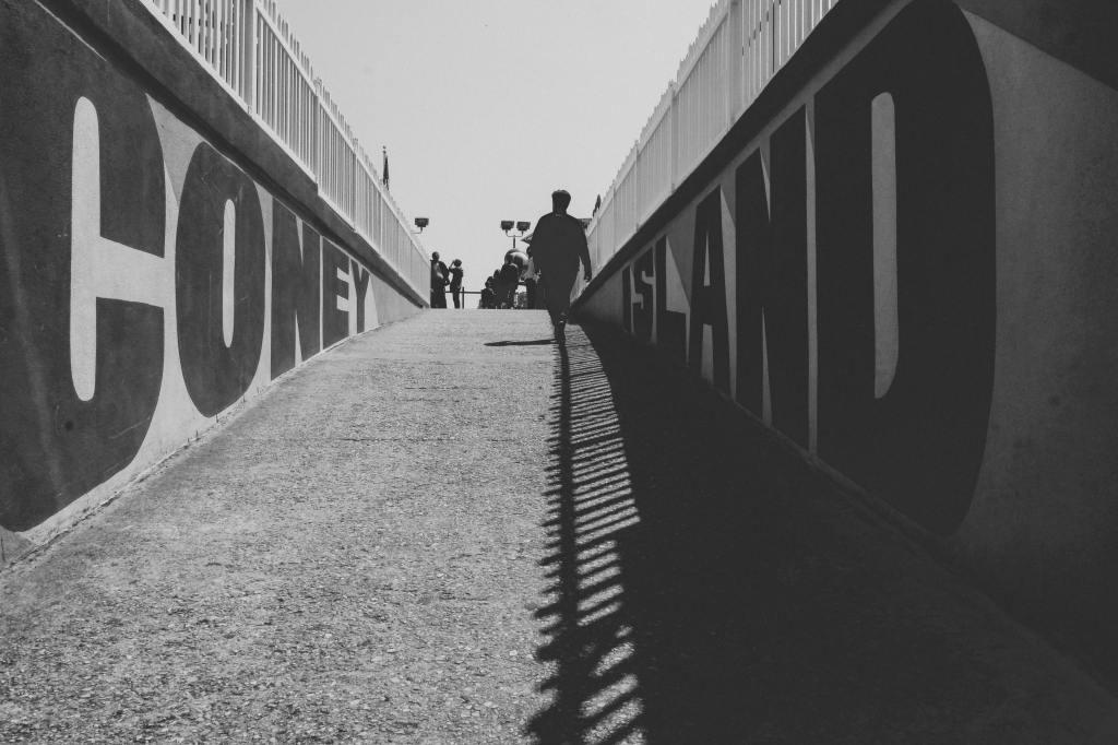 Man walking up path towards Coney Island