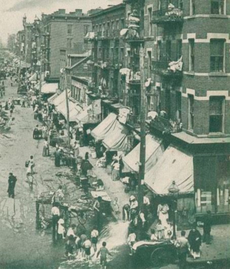 Lots of people outside a tenement on Hester Street